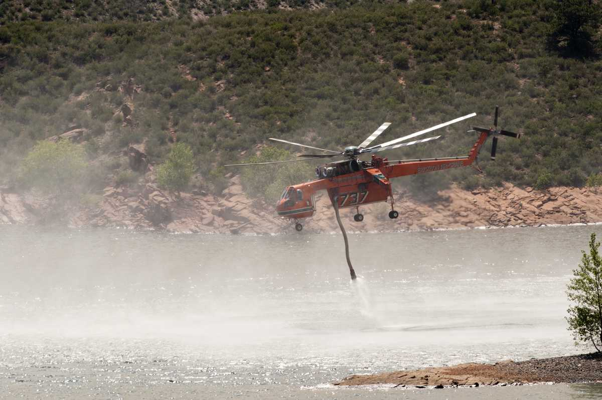 An Erikson Air Crane heavy tanker fills up with 2600 gallons of water from Horsetooth Reservoir. Photo: John Sheesley for the Rocky Mountain Collegian