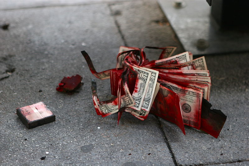 Don't worry, that red stuff isn't blood. It's just an exploded dye pack. Courtesy of Wikipedia.