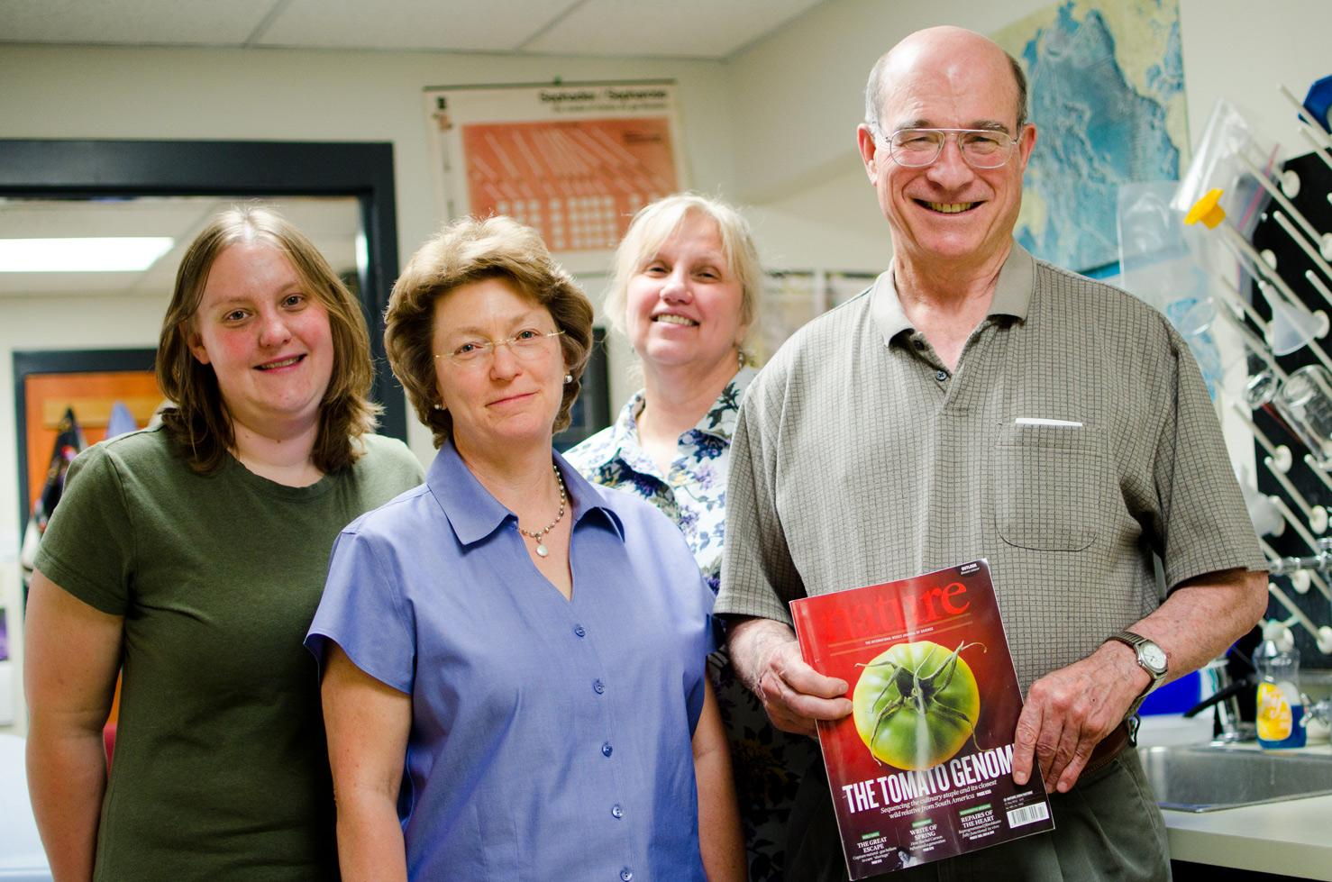 From left to right, Lindsay Shearer, Lorinda Anderson, Suzanne Royer and Stephen Stack stand with a copy of Nature. The four are part of a multinational, nine year project that sequenced the tomato genome. Photo by Nic Turiciano for the Collegian.