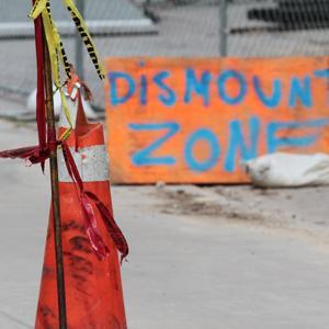 Construction sites will post specific dismount zones.