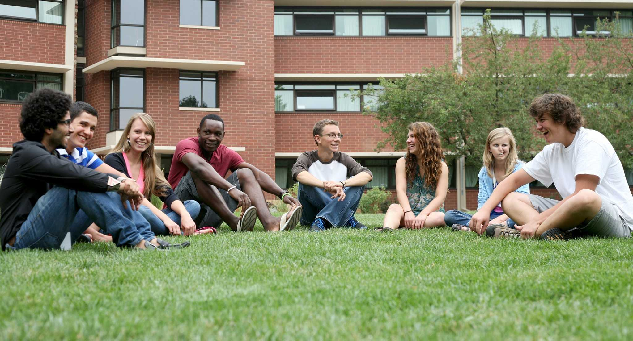 Members of the Global Village Residential Learning Community, a community of international and domestic students, meet outside of Parmelee Hall Monday. Global Village is just one of many programs in place at CSU to support a growing population of international students from over 80 countries around the world.