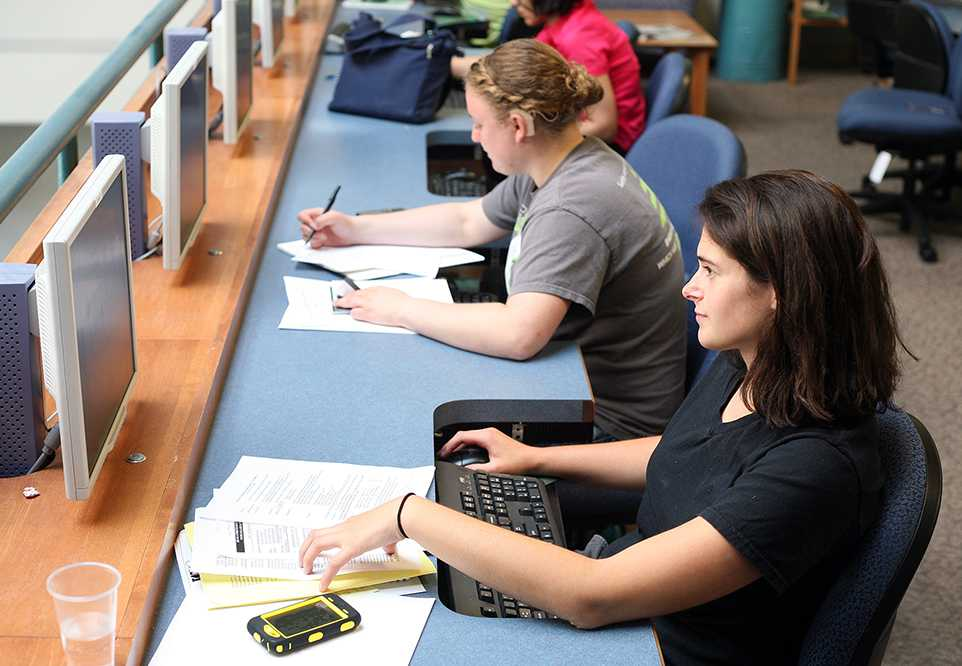 Rachel Acker, a junior environmental engineering major, studies with Alexa Garfinkel, center, the activities director of the Society for Women Engineers, in the Internet Café Tuesday. Acker and Garfinkel represent the record breaking cohort of women interested in Engineering at CSU.