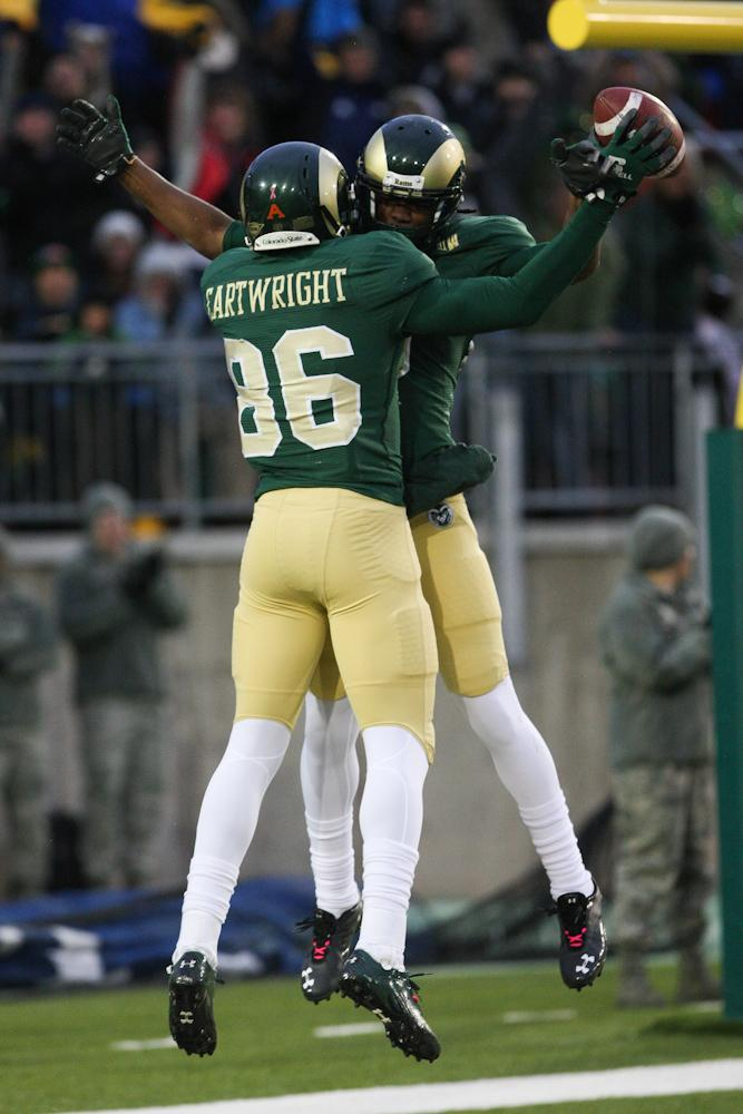 Kivon Cartwright (86) celebrates a touchdown with Marquis Law (9) during the first half of Saturday game against Fresno State. The touchdown was called back after a flag was thrown on the play and the Rams eventually fell short to the Bulldogs 28-7.