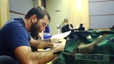 Army veteran Drew Waldbauer attends class on Friday. Waldbauer works at the Adult Learner and Veteran Services center where the goal is to help support the transition, education, and involvement of adult learners and veteran students.