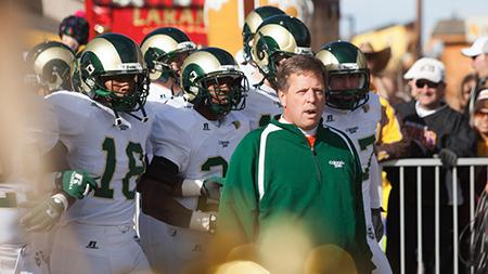 Head Coach Jim McElwain leads the team onto the field at the Wyoming game this past Saturday. The Rams will play UNLV this Saturday at 5 p.m. at Hughes Stadium.