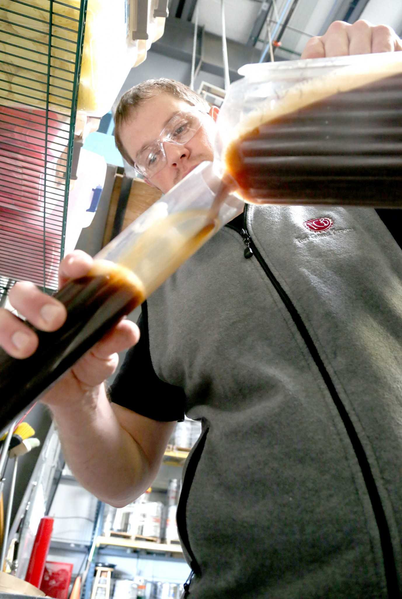 Fort Collins Brewery lead brewer Adam Glaser prepares to take a gravity reading on a beer Thursday afternoon. Tonight Beer University starts at the brewery where the topic will be Beer Sensory 101.