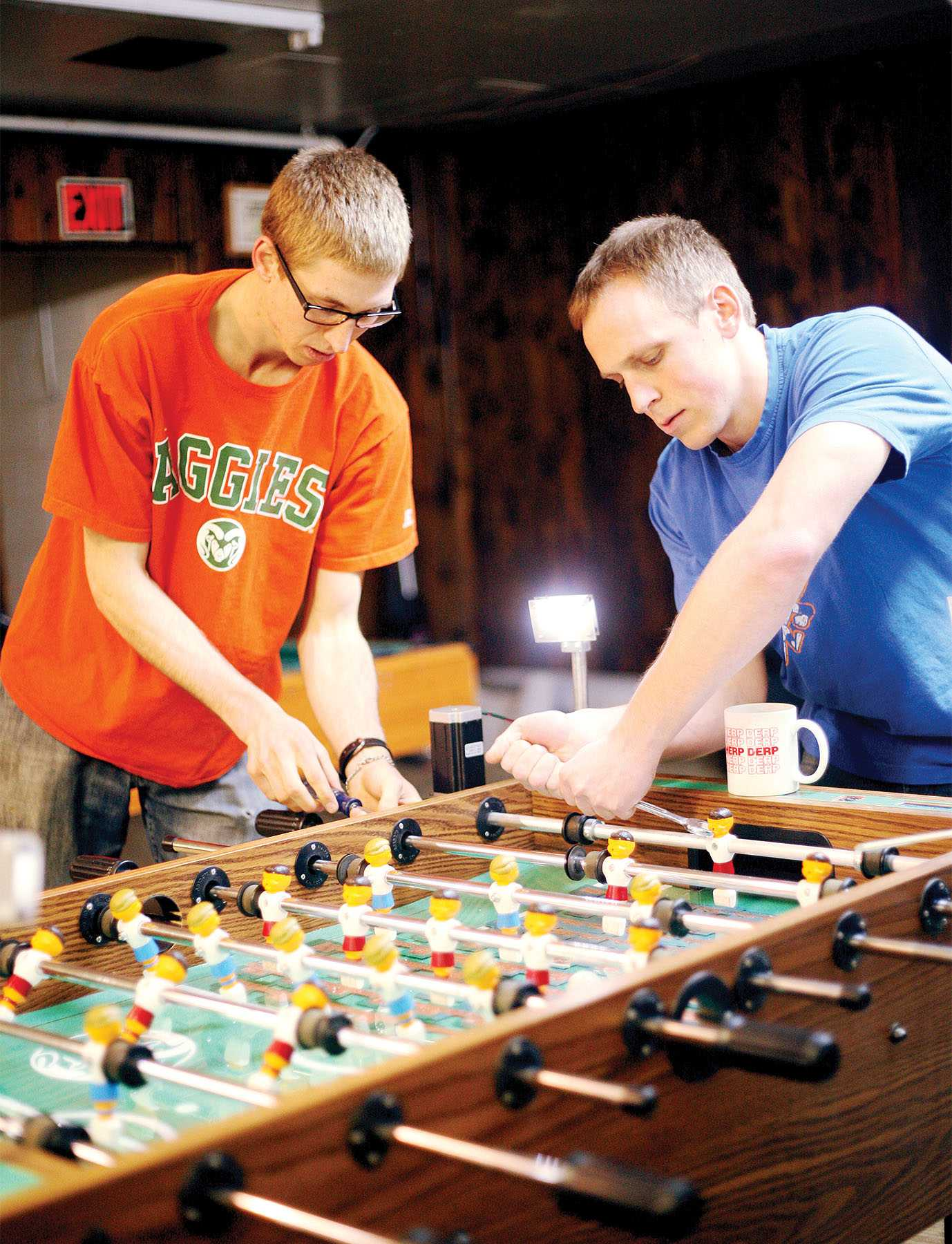 Mechanical Engineering students Darryl Beemer, left, and Kevin Westhoff, right, make adjustments to their Mechatronics final project, a foosball table with a capacitive grid that automatically moves the goalie, Friday afternoon. The College of Engineering has grown by 25% over the last decade, which is the largest growth of any college at CSU.