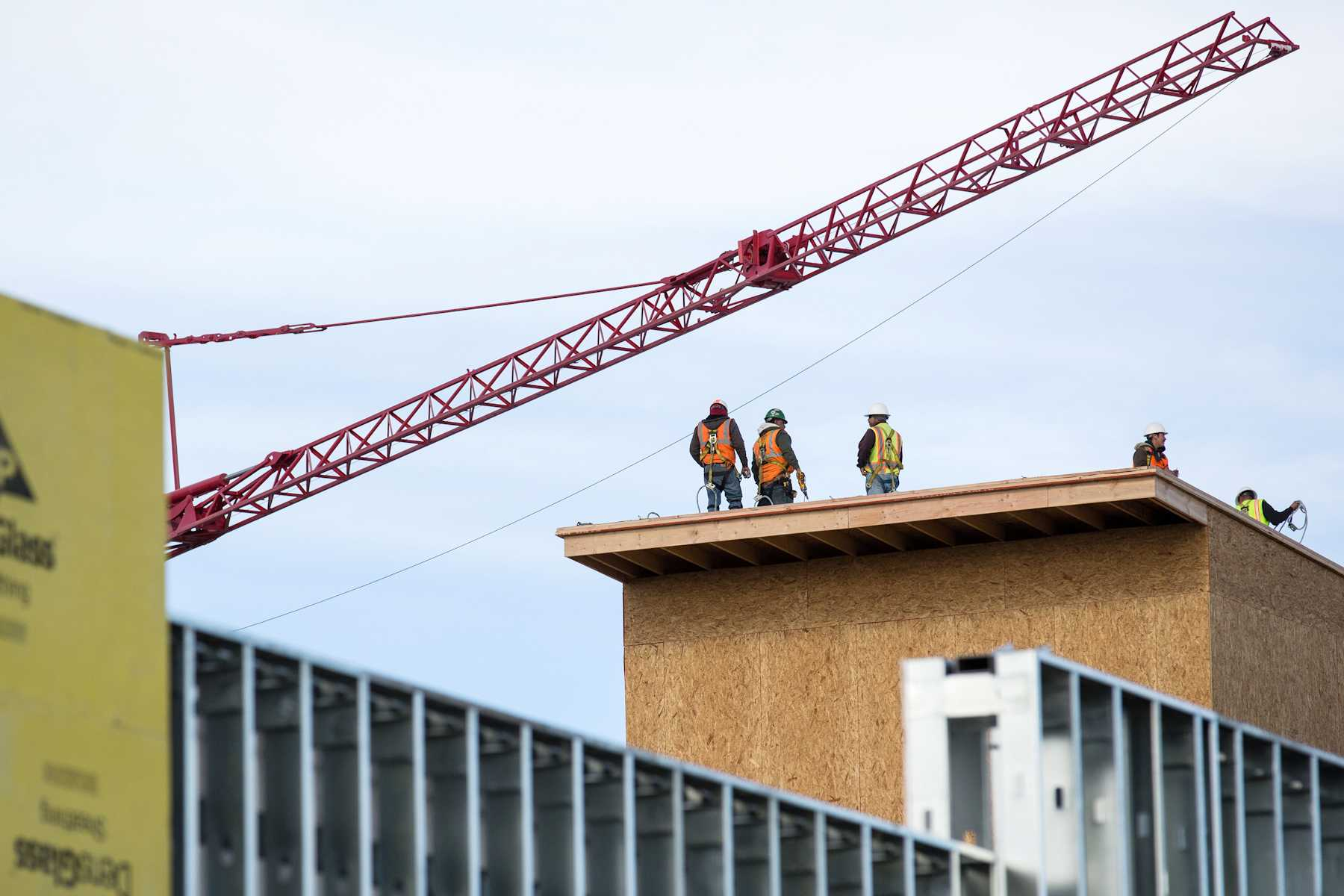 A constuction crew works on the roof of the new student apartment complex, The Summit, on the corner of College Ave. and Prospect St. The complex is expected to be completed in summer of 2012 and is apart of a plan to increase the student housing in Fort Collins.
