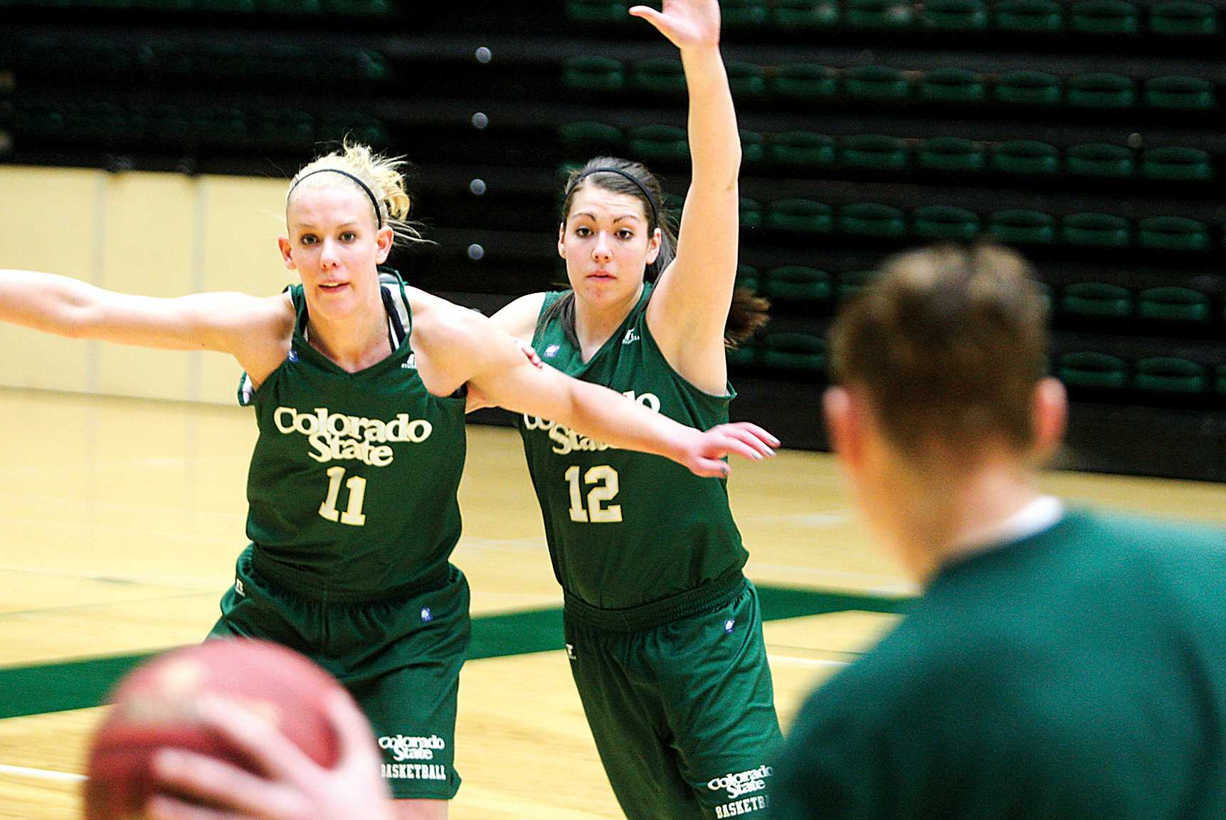 Sam Martin (12) defends Meghan Heimstra (11) at practice on Monday in Moby Arena. The Rams prepare to take on Nevada in Moby Arena at 7 Wednesday night.