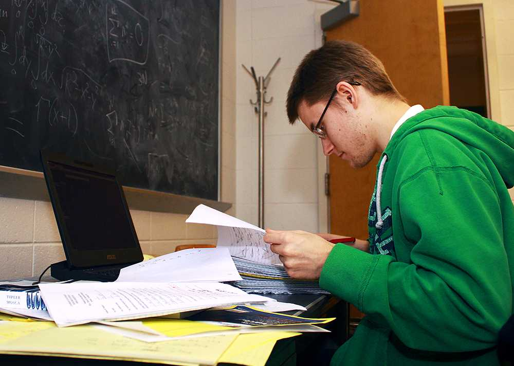 Second year graduate student and TA, Dan Pearson, grades papers for a physics course. Much of the grading and research is done by the graduate students at CSU.