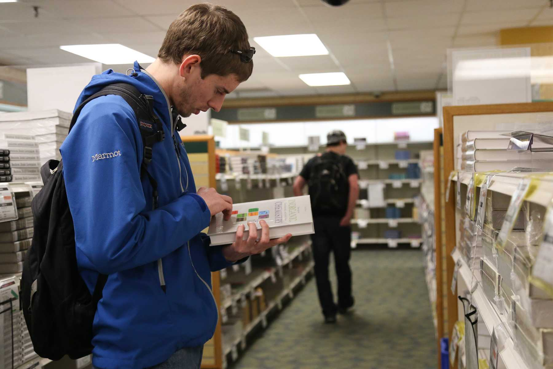 Junior Biology major Miles Eckley shops for books at the Lory Student Center bookstore Monday. With the rising cost of tuition and being a student in general, the university is working on a bill that will establish a tax holiday for all Colorado State university bookstores.