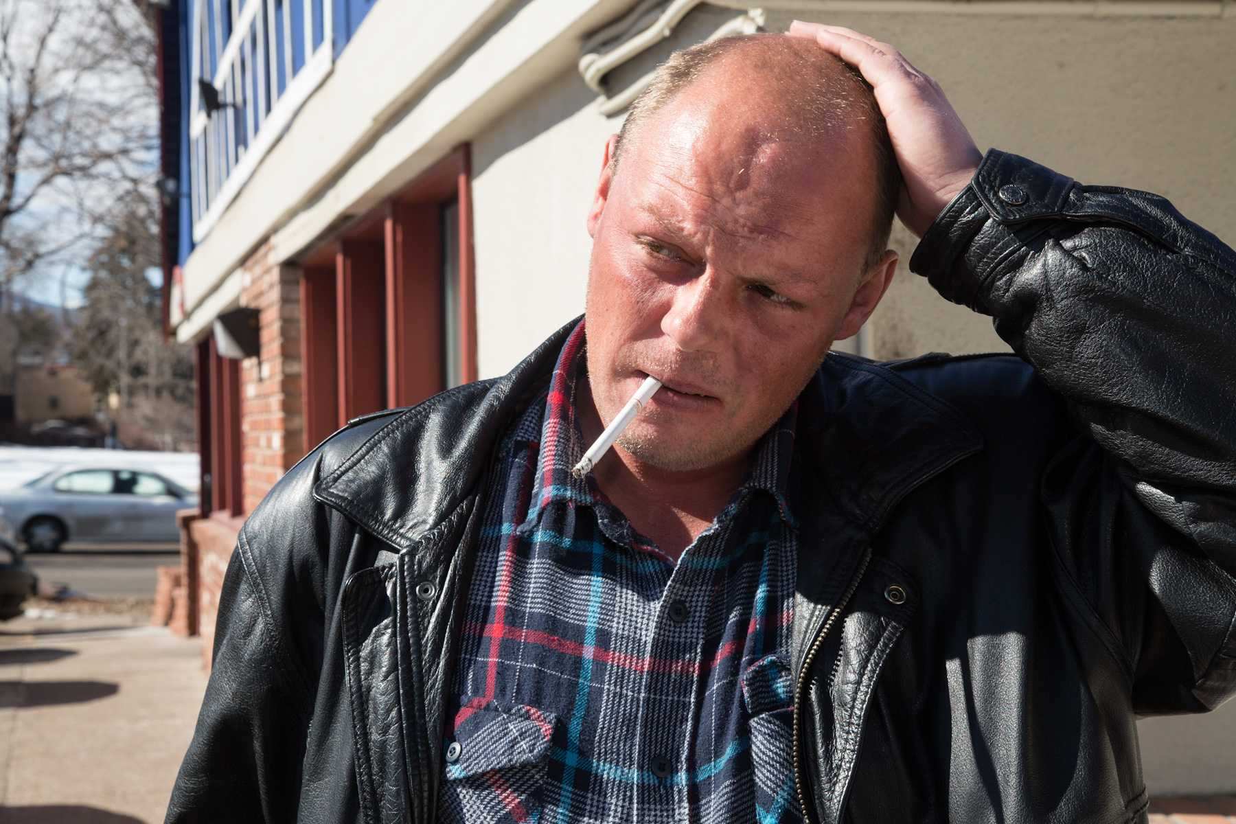 Fort Collins resident Todd Smith smokes a cigarette ouside of IHOP on College Ave. Wednesday. Smith has been a regualr to IHOP for the past 10 years, spending his days of sipping coffee and reading.