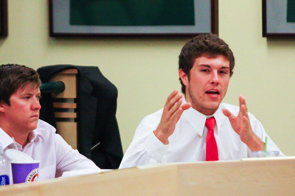 Robert Duran, right, Chief of Staff for ASCSU, speaks at the senate meeting in October in the Senate Chambers of the Lory Student Center. Duran graduated in 2012, but still holds his position as Chief of Staff at ASCSU.