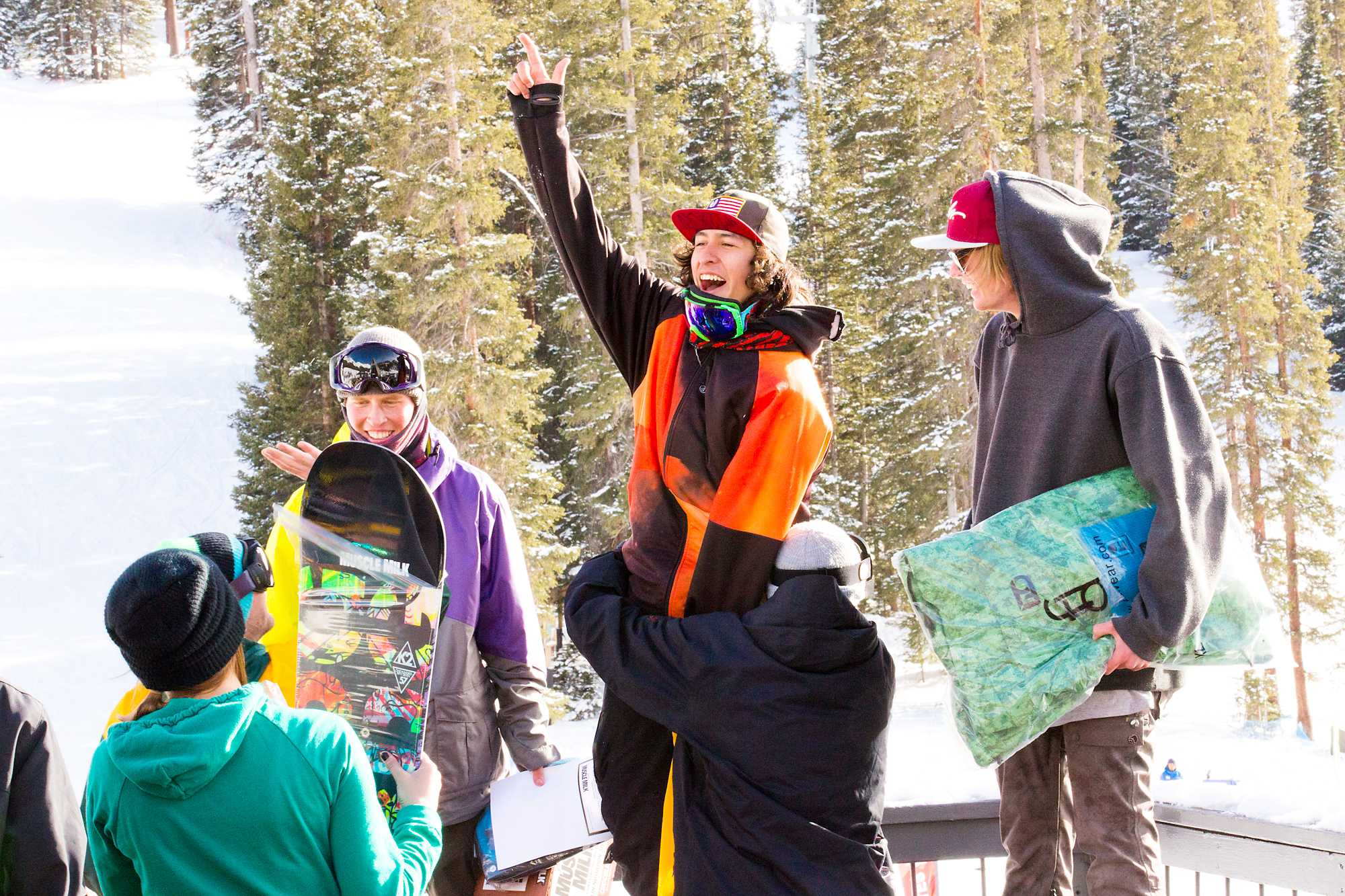 CSU's Dimitri Moreno (middle), Steve Merg (right) and Pierce Cameron (left) stand on their 1st, 2nd and 3rd place podiums respectively at the Snowdown Men's Snowboarding rail jam at Arapaho Basin on Saturday afternoon.