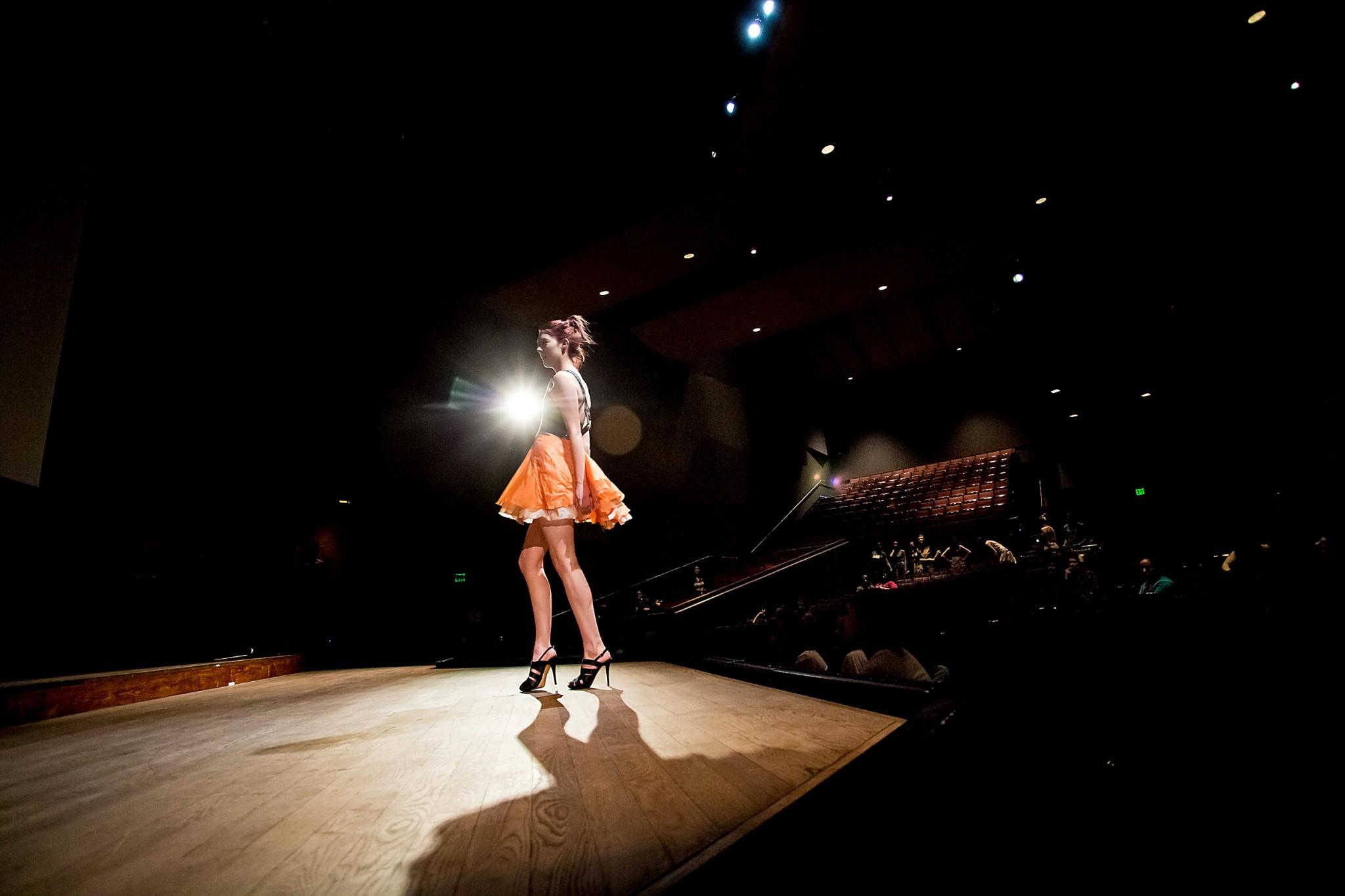Jessie Weimer poses in a parachute dress during a dress rehersal Thursday night for the spring fashion show in the Lincoln Center. The show is put on by CSU Fashion Group International.