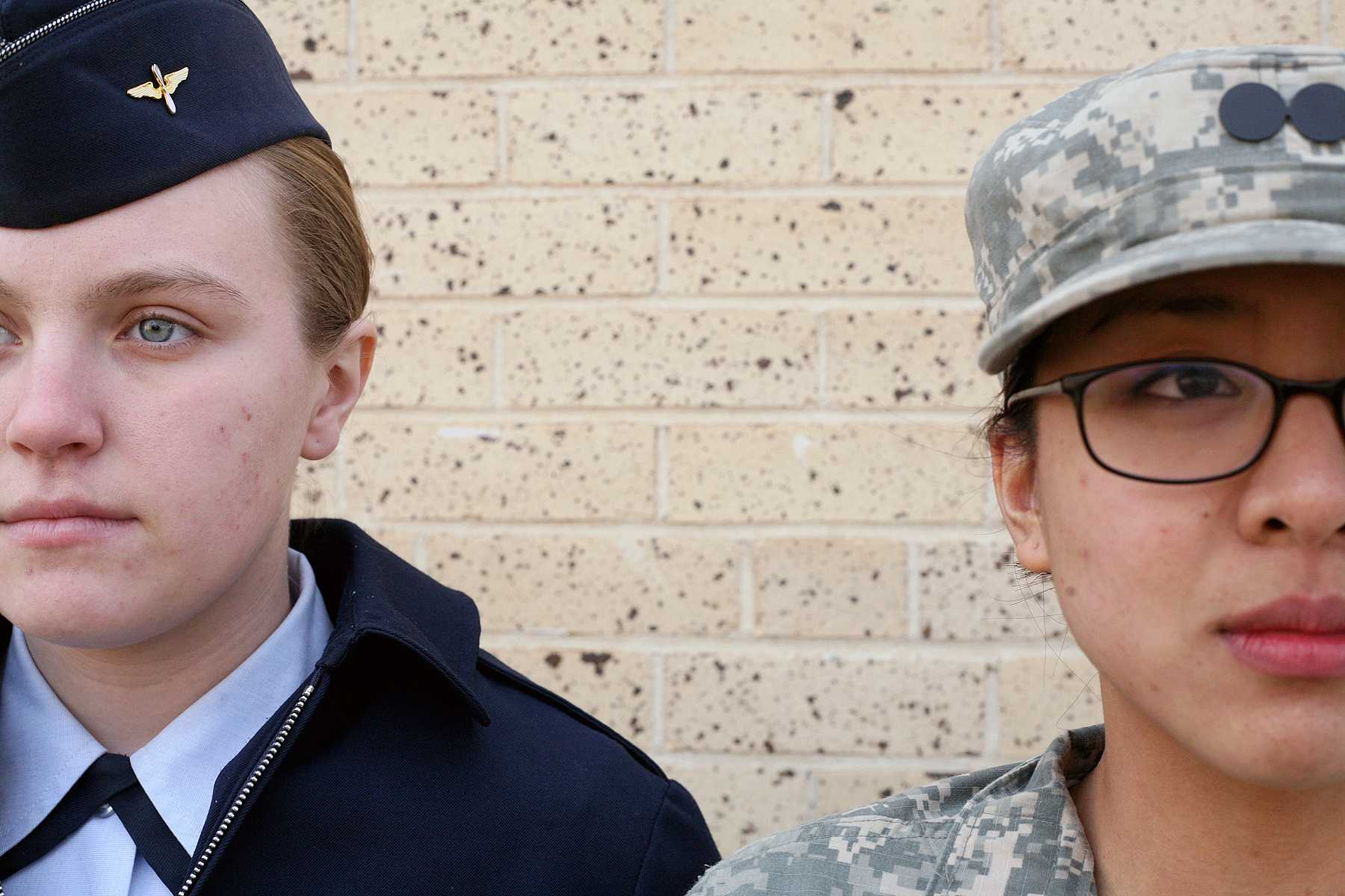 Air Force ROTC member Holly Frock, left, stands at attention with Army ROTC member Rebecca Gogue, right, outside of the Military Sciences Building.