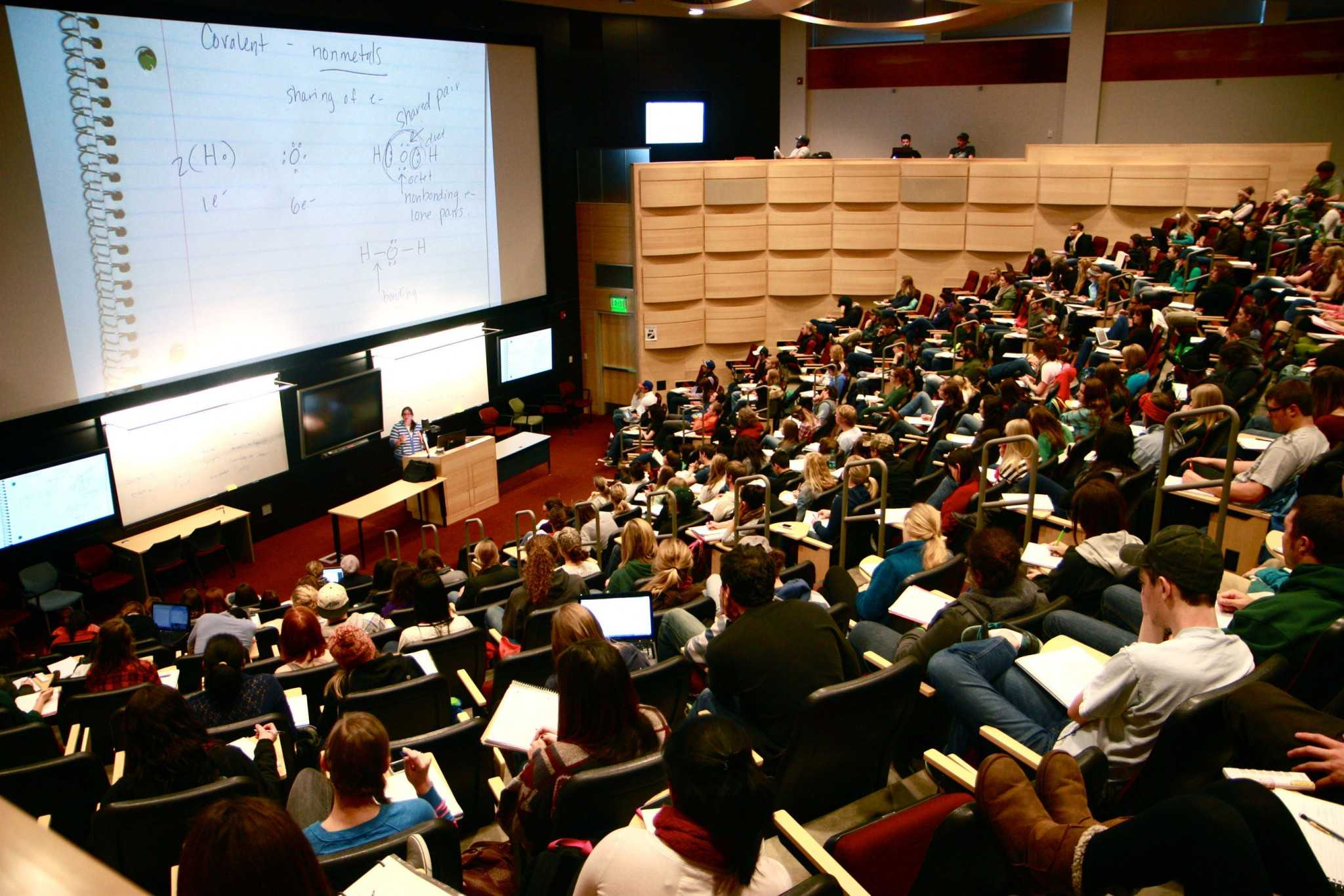 A 400 seat lecture room in Behavioral Sciences Building is packed full with mostly Freshman students enrolled in Chemistry 107.