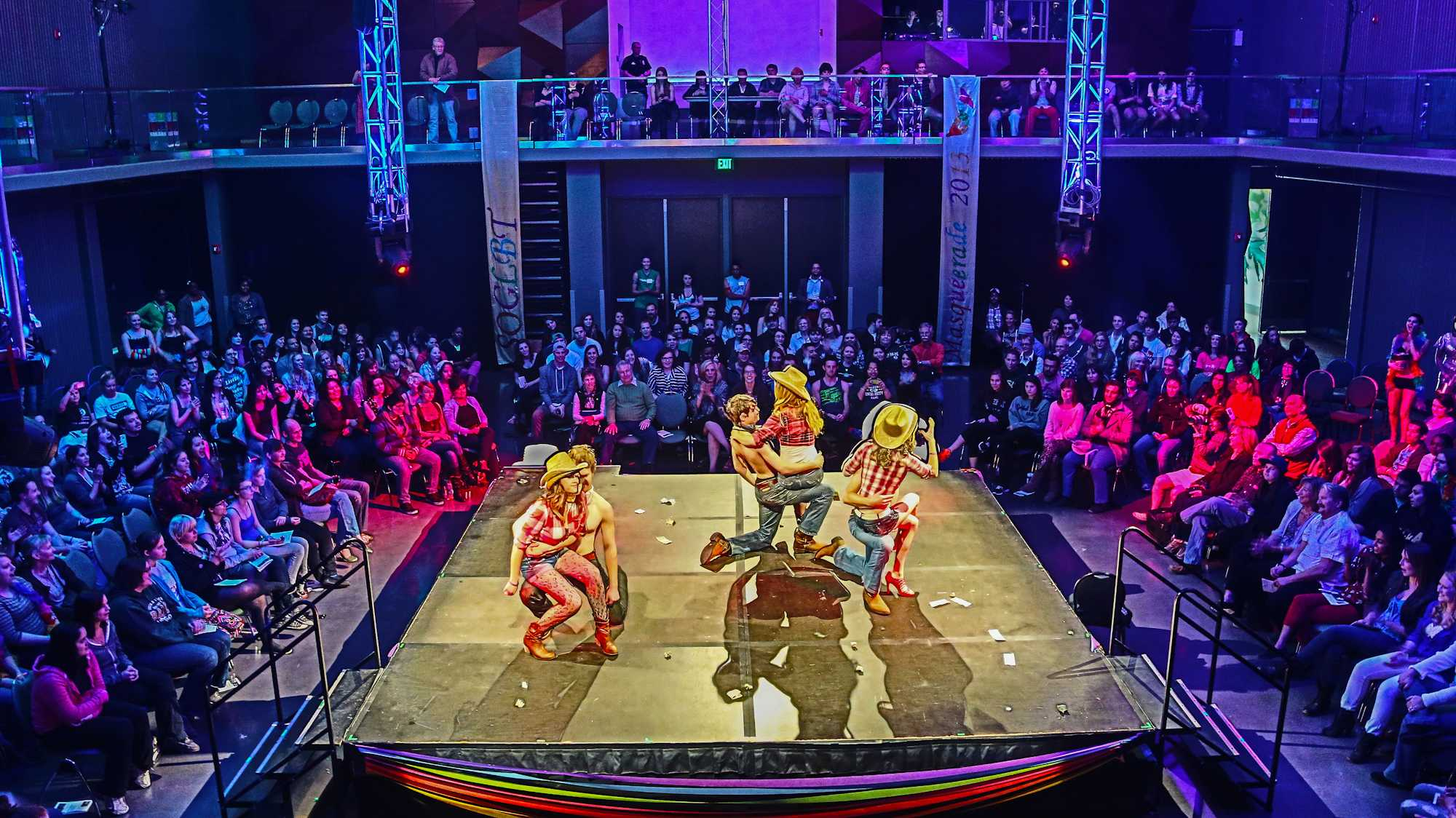 """Performers dance to the song """"Feel Like a Woman"""" at the annual SOGLBT drag show in the Lory Student Center Theatre Saturday."""