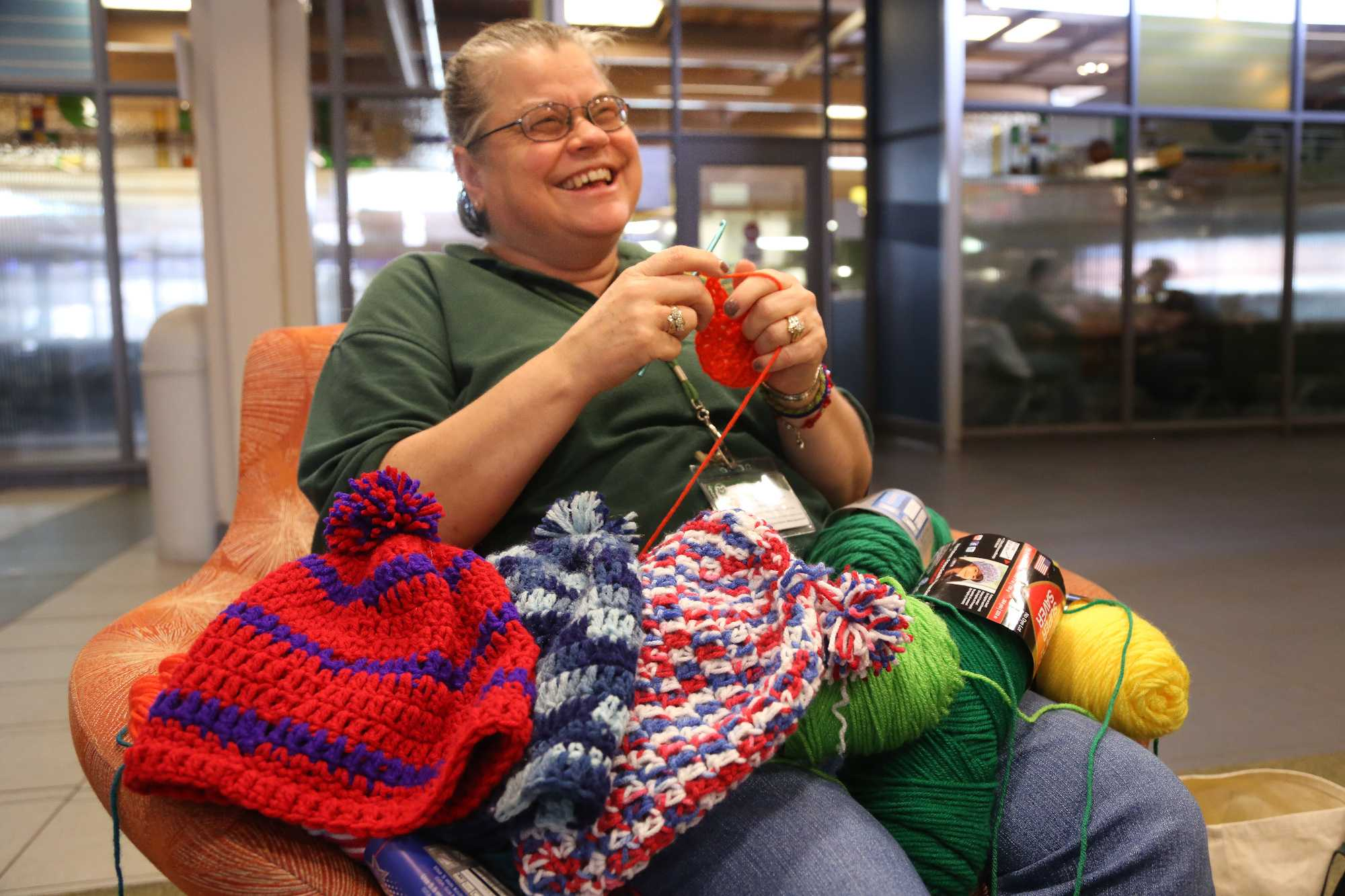 Braiden Hall Environmental Technician Ellen Becker crochets a hat in Braiden last week. Becker, who began crocheting for students 7 years ago, now makes hats for every resident in Braiden as well as Tony Frank and other prominent figures on campus.