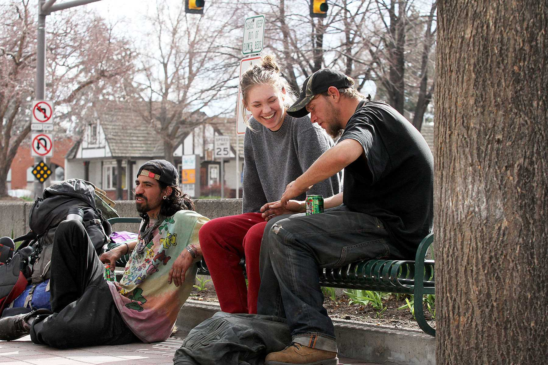 "Collegian reporter, Cailley Biagini, talks to two ""hobo travelers"" named Fishtaco (left) and Beer (right) in Old Town on Friday afternoon. Biagini went undercover for an afternoon to find out how Fort Collins homeless people are treated."