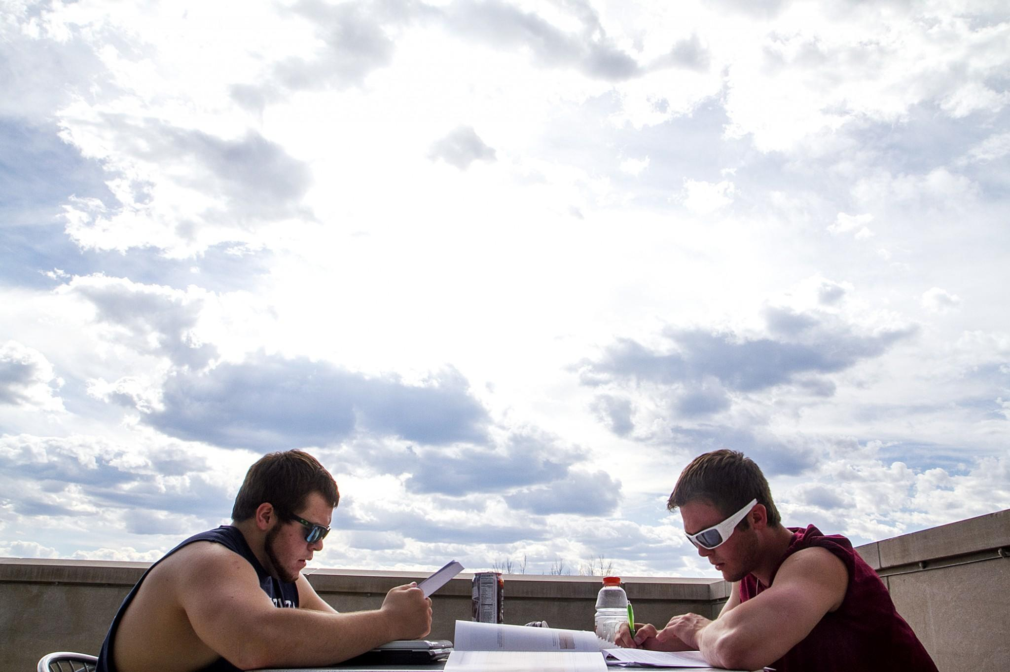 Sophomores Rusty Andres (left) and Hondo Anderson (right) study for finals atop the Behavioral Sciences Building on Sunday afternoon. With finals week ahead, students look forward to a well desserved break with Summer skies ahead.