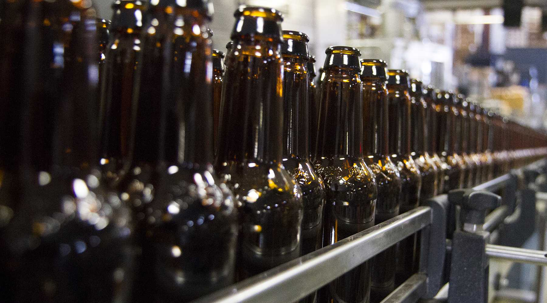 Bottles wait on the bottling line to be filled at Odell Brewing Company on Wednesday afternoon.