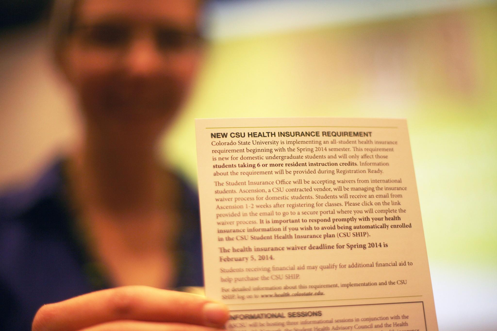 ASCSU Executive Direct of Health Mackenzie Whitesell holds up an informational card about the change in the CSU health care requirements with the implementation of Obamacare. Health insurance is now mandatory for all CSU students to have and if student's do not provide proof of their health insurance by Feb. 5th they will be automatically enrolled in CSU's health plan.