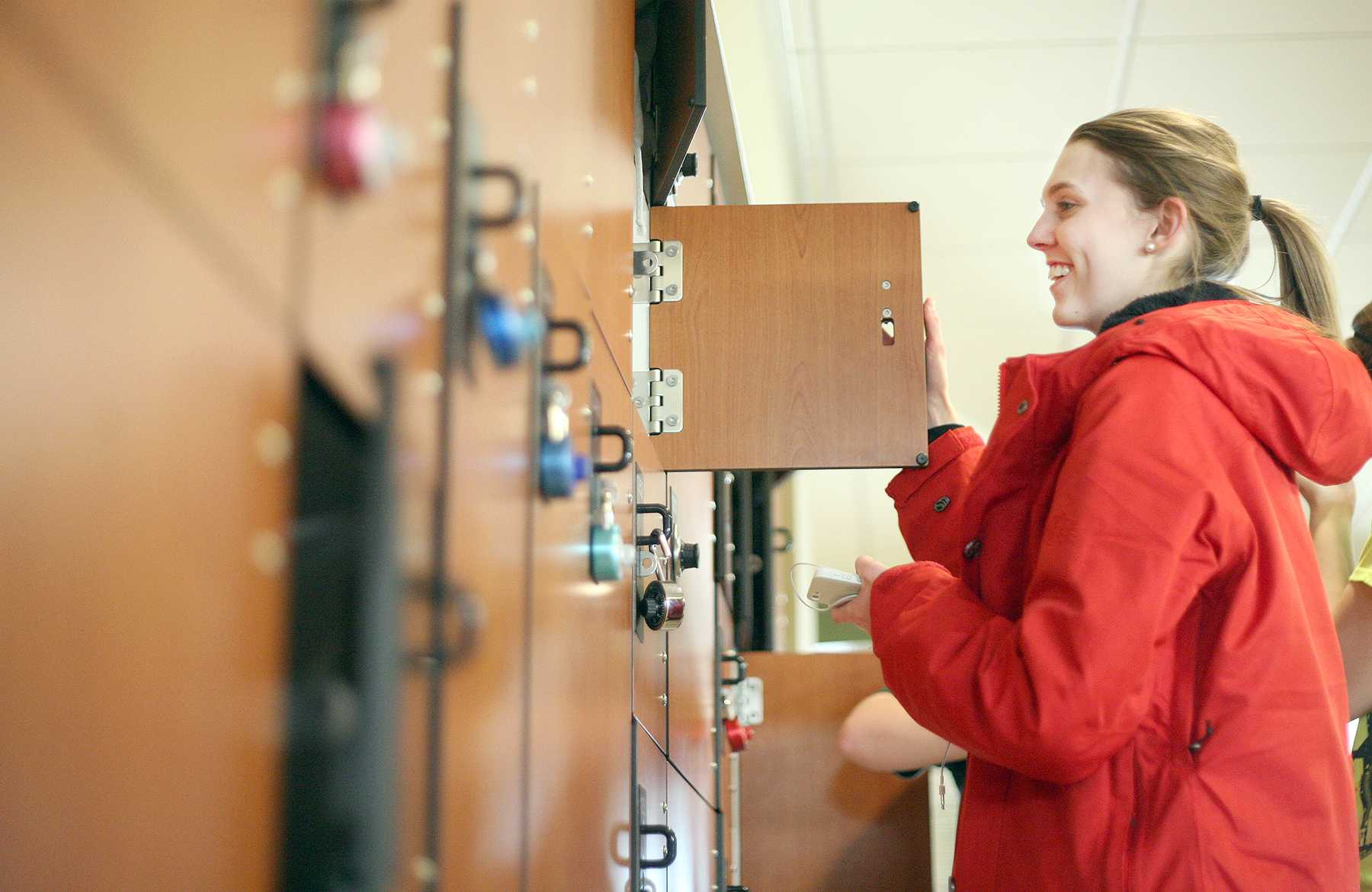 First year student Attie Pennybaker grabs her iPod out of the temporary lockers in the Recreation Center Tuesday. Lockers are available for rent each semester and sell out quickly.