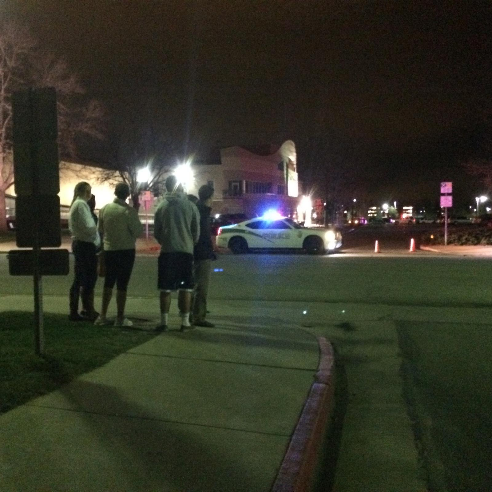 CSU students look on as campus police officers investigate a suspicious object outside of Moby Arena. The object turned out to be harmless according to police.