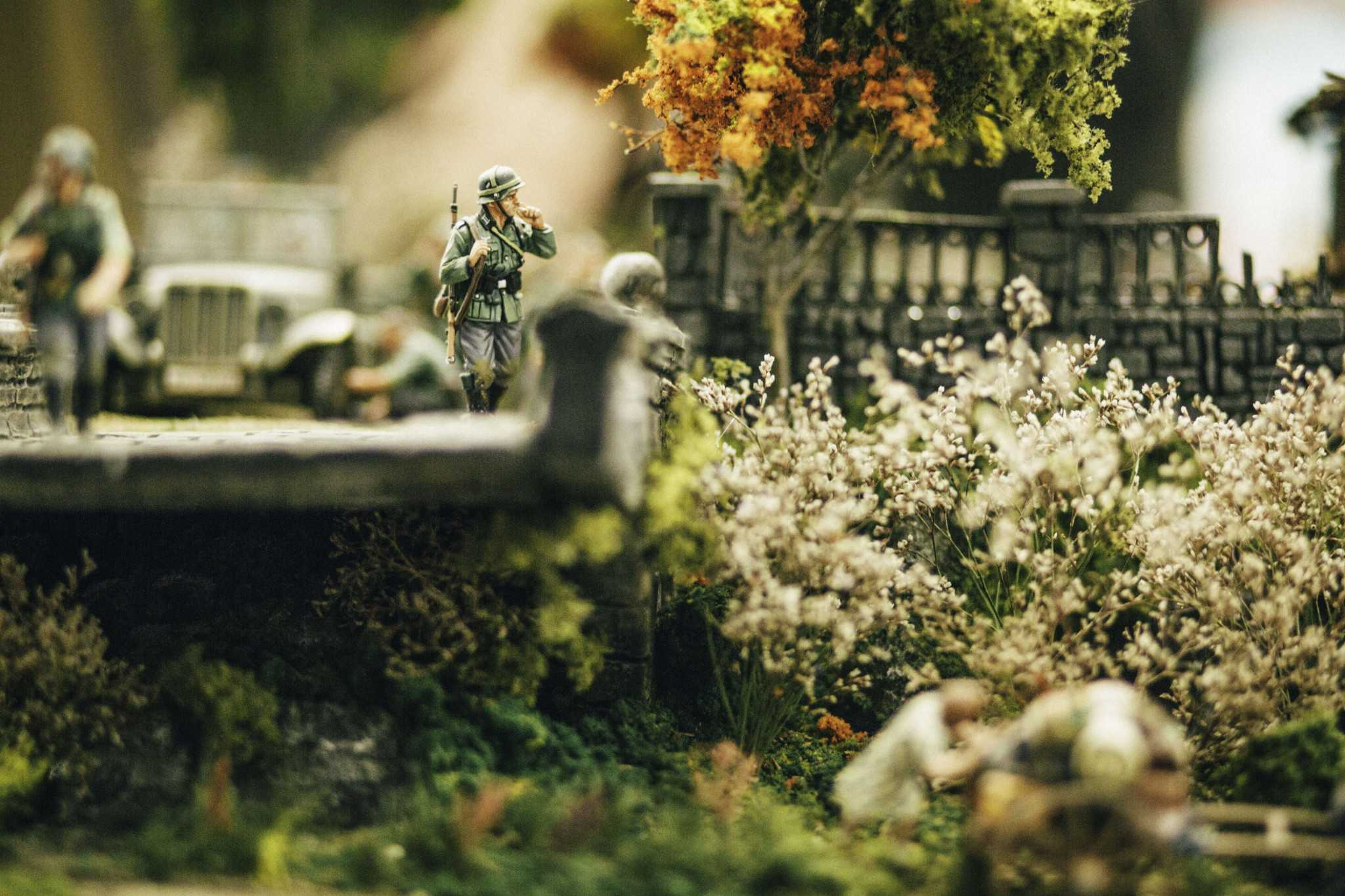 """A detail shot depicting a miniature German soldier smoking in Andres Flores' diorama titled """"Blitzkrieg."""" Paying close attention to detail, Flores recreates in miniature form German movement through France in 1940 via their infamous Blitzkrieg, or """"lightning war,"""" war plan."""
