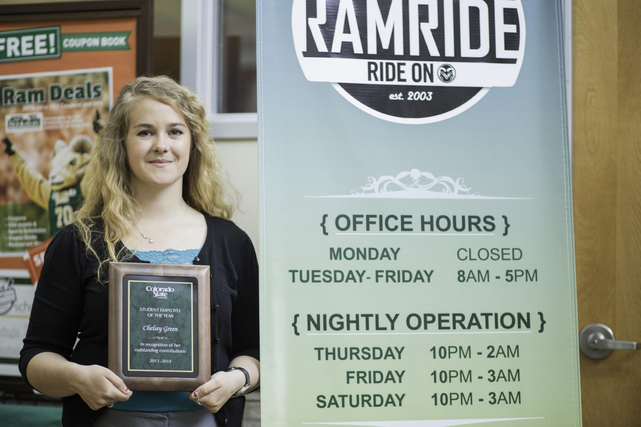 "Chelsey Green stands outside the RamRide office in the Lory Student Center with her plaque honoring her as the ""Student Employee of the Year"" Tuesday afternoon."