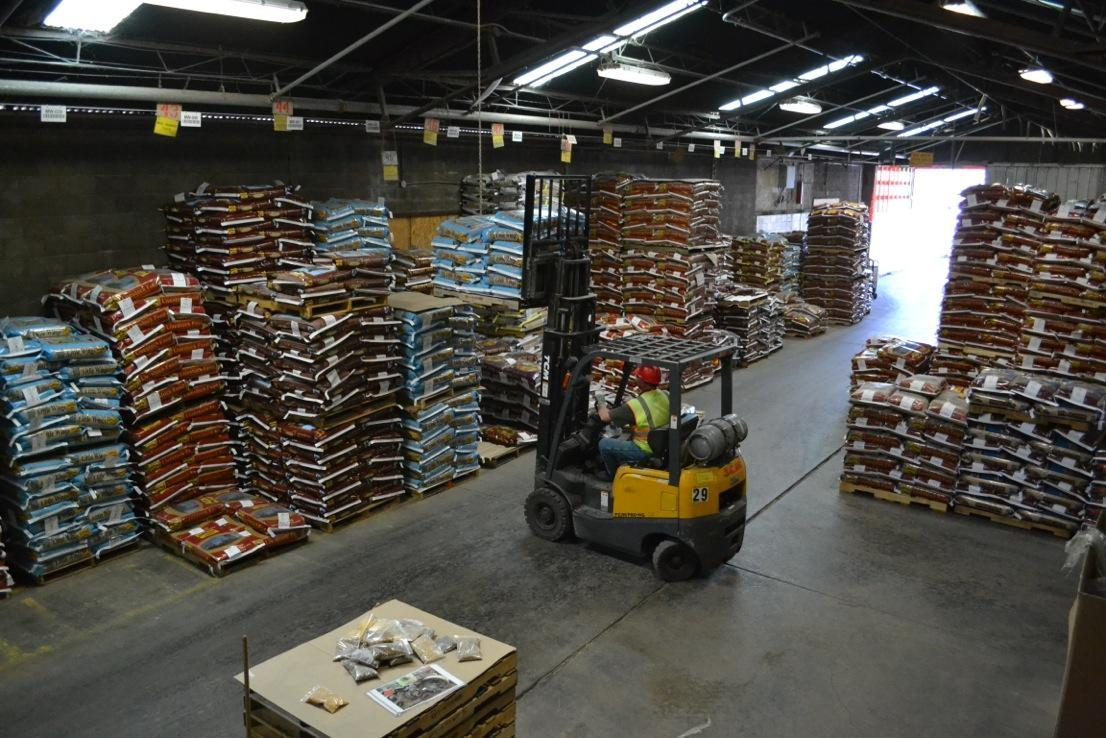 A fork lift at Ranch-Way Feed moves newly bagged feed product to pallet stacks. Photo credit Dixie Crowe.