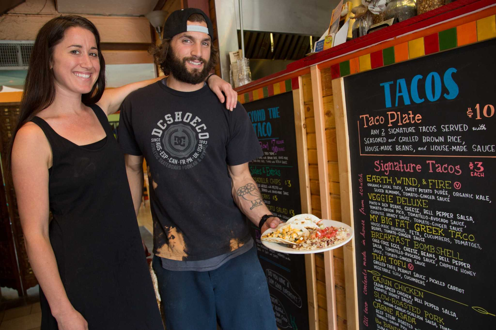 Dam Good Tacos co-owners Ali Hatcher and Michael Falco at their shop in the ally on Laurel St. Ali is a Colorado State University Public Health alum who opened the shop with Michael last June.