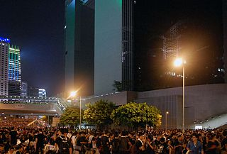 Hong Kong protests beneath Chinese central government offices. (Photo Credit: Wikimedia)