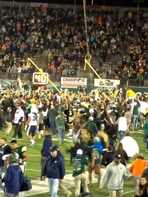 The crowd rushes on the field following CSU's win on Saturday night. (Photo credit: Nick Petersen)
