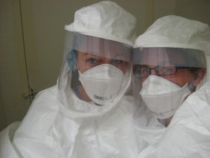 Researchers Danielle Adney and Vienna Brown conduct experiments within a secure environment.