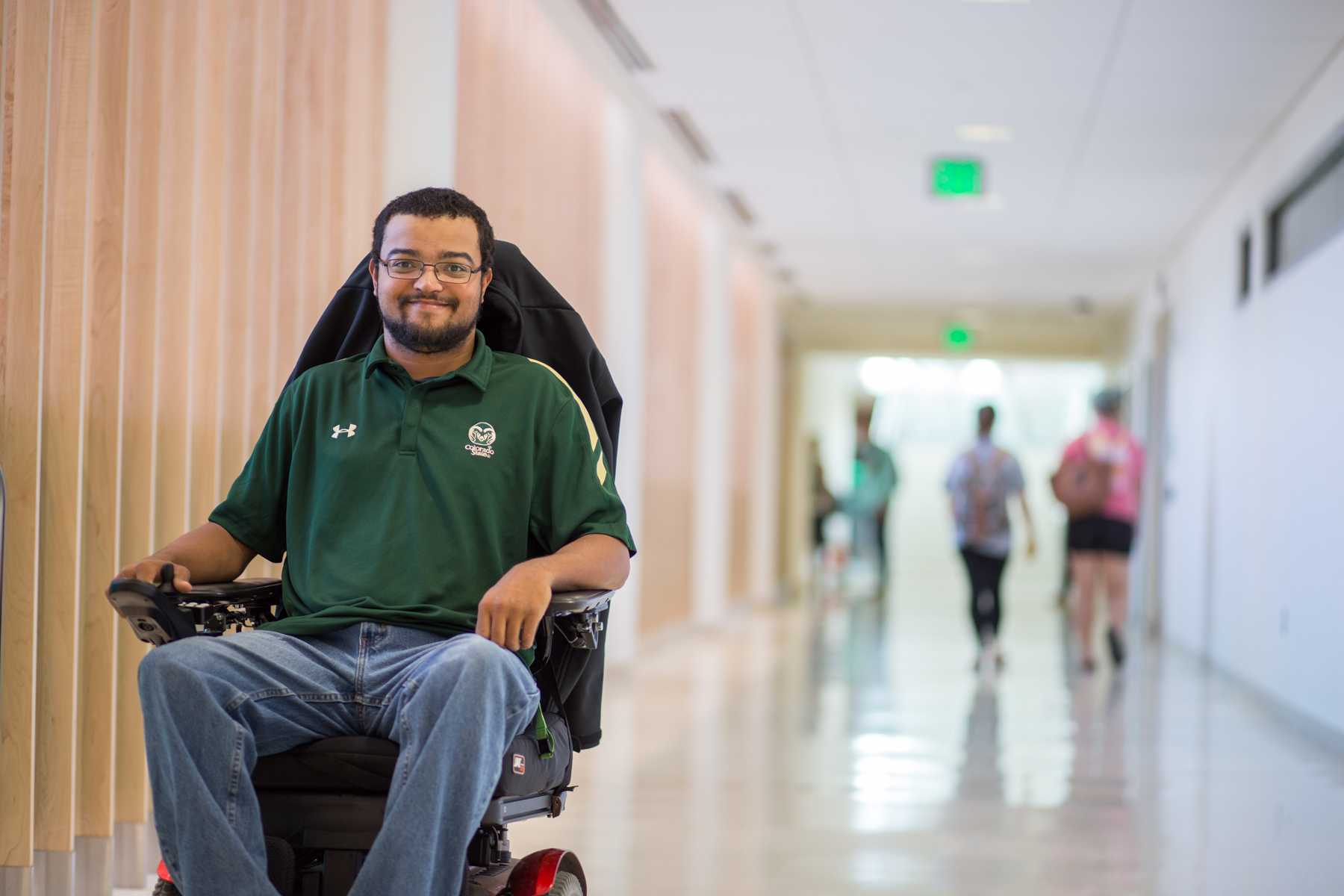 Micheal Mills (29) is a Graduate Student studying Student Affairs and makes use of wheelchair ramps daily. Photo Credit: Ryan Arb