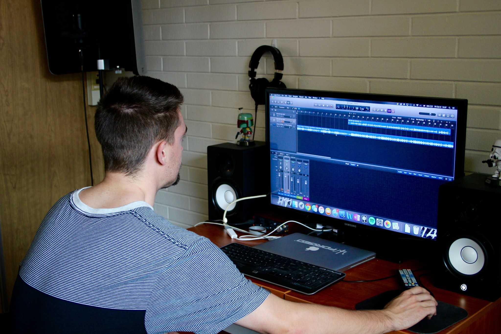 Josh Weemes, also known as Emprovyze, reviews a recording in his studio he built in Corbett Hall.
