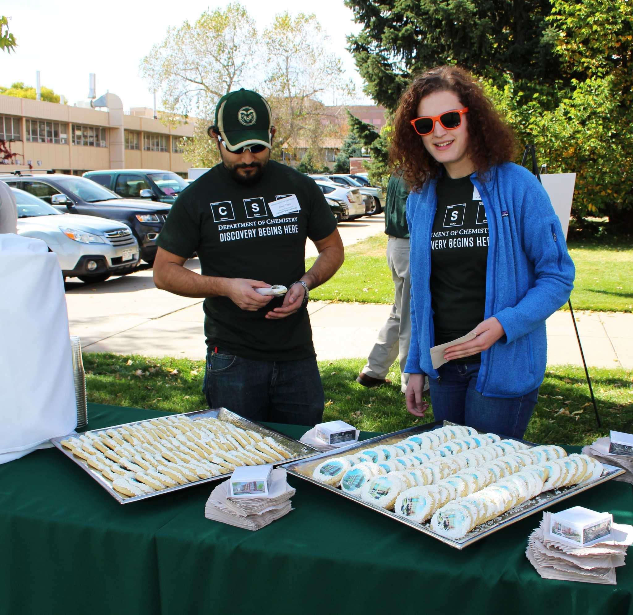 Kathryn Tracy and Jesus Tapia, chemistry graduate students, treat themselves to cookies decorated with a picture of the new Chemistry Research Building.