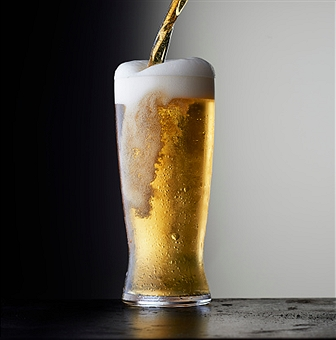 Simple stock beer on a dark background.