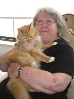 A Pets Forever program participant poses with her cat. (Photo courtesy of Pets Forever.)