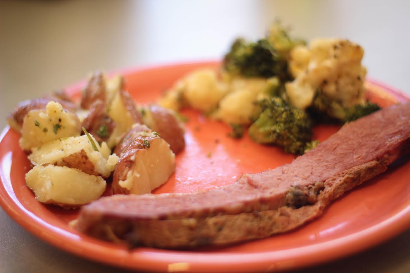 A cut of corned beef is one example of an entree that adheres to the paleo diet. Broccoli, cauliflower and roasted potatoes are great options for sides. Individuals on a paleo diet may only consume food products that a caveman would have eaten. Photo by Jenna Fischer.
