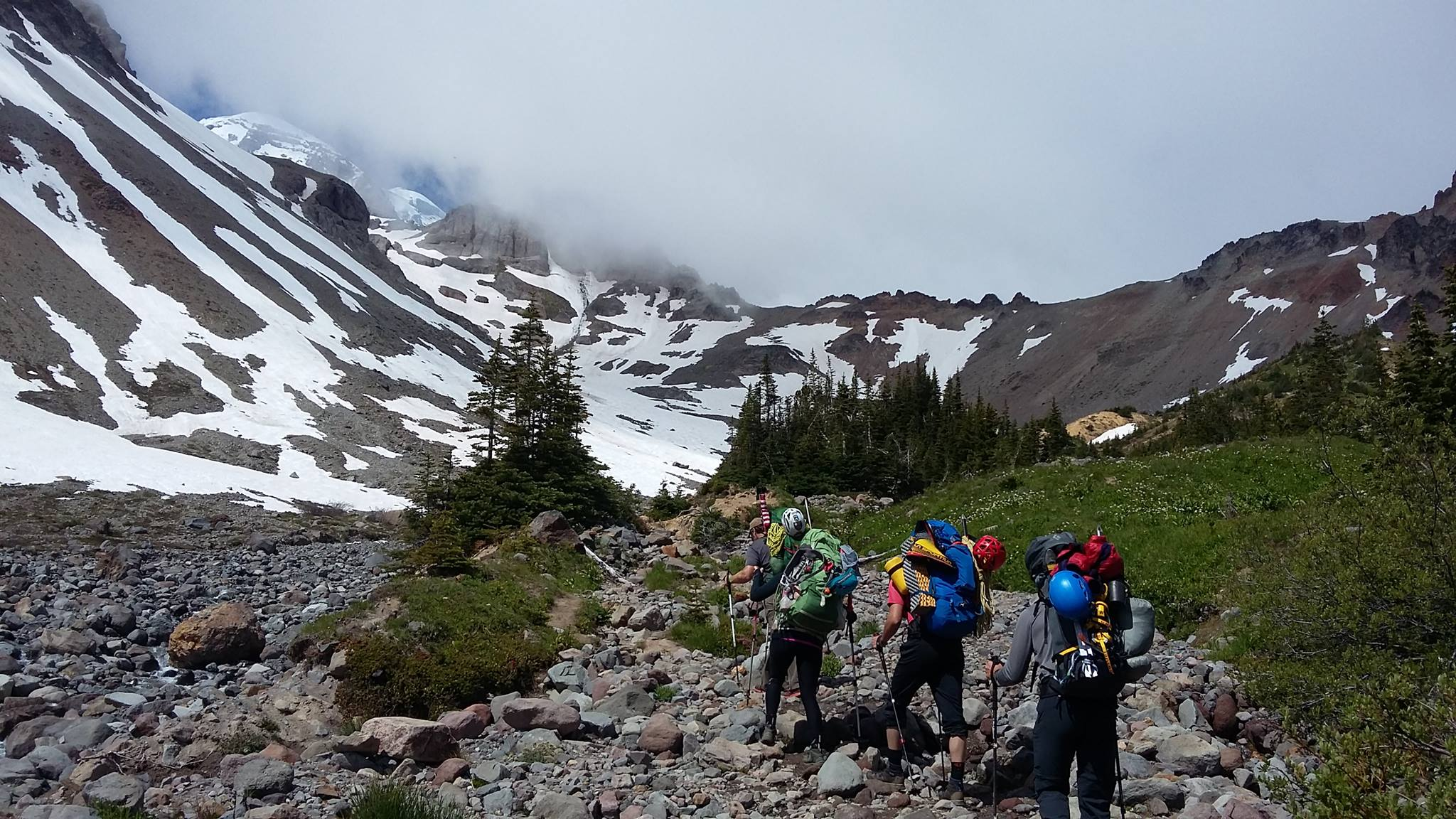VetEx Climbers on the lower portions of Mount Rainier. From left to right: Nick Watson, Sandra sandrute, Nathan perrault, Nathan vass. (Photo By: Nick Watson)