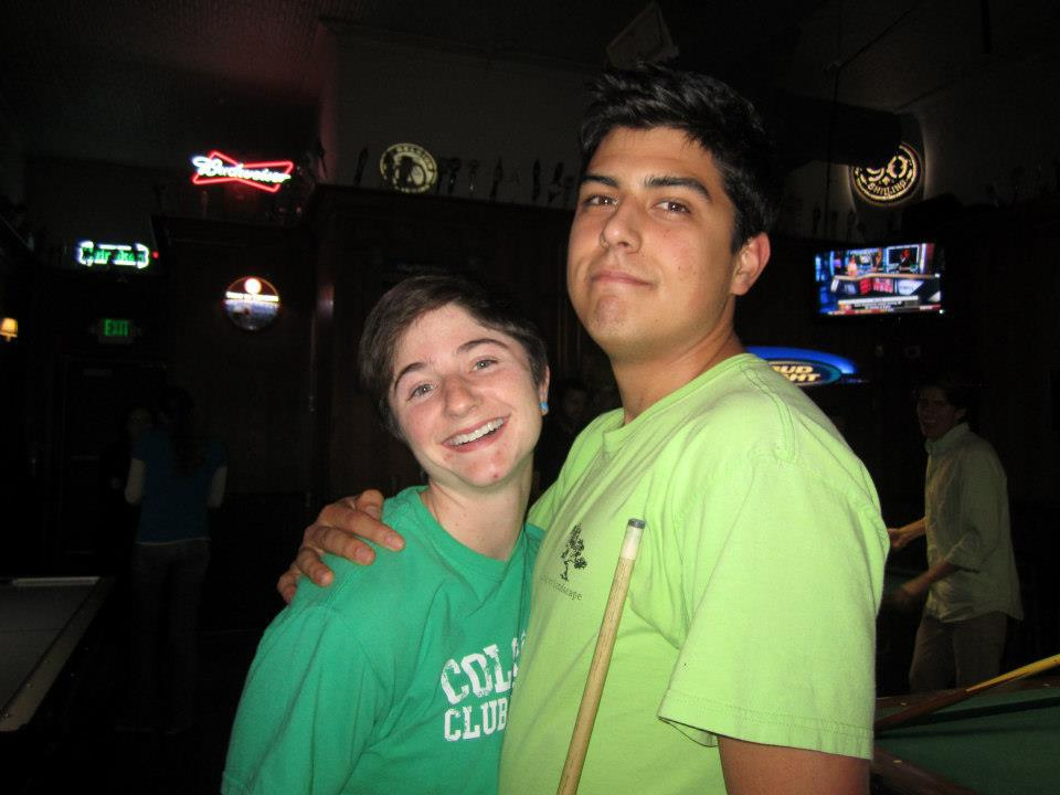 Amy Brobst, left, and friend Ben Canalen pose for a photo in a pool bar. Amy met Ben in her sophomore year at CSU when they both applied to be ambassadors in the Department of Agriculture.