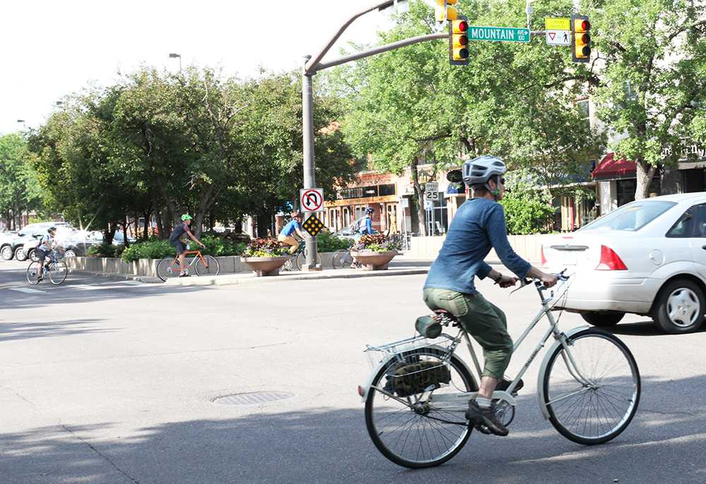 Bicyclists ride through Old Town to get to the next Bike to Work station. Photo by Dina Alibrahim Fike.