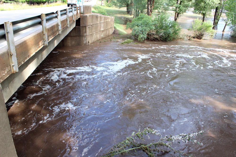 Flood waters rise to about two feet below a bridge on West County Road 24 in Loveland. Earlier that day on September 13, 2013, residents said the bridge was completely submerged by the flood.