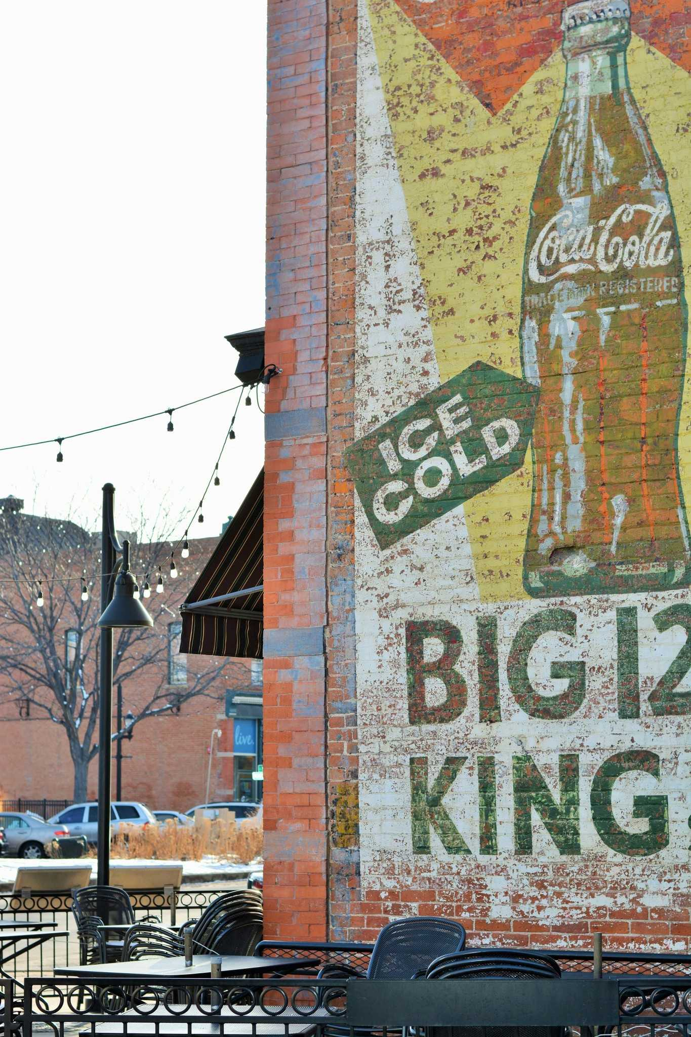 This vintage Coca-Cola mural adorns the side of Cooper Smiths Brewing Company.