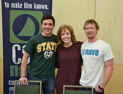 (From left) Ryan Krammes, Emily Natelborg, and Garrett Schlegel, with CSU navigators pose for a photo during the Faith Fair Monday.