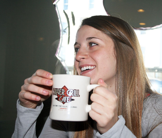 Student drinks a cup of coffee at Silver Grill Cafe.