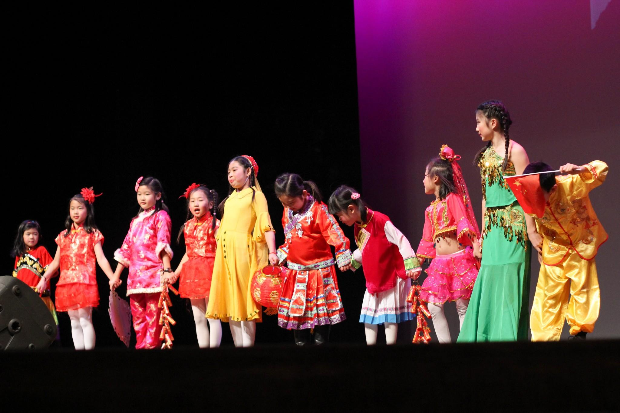 Students of the Hoaxing Chinese School display a variety of traditional Chinese clothing styles. The fashion show was a part of the Chinese New Year celebration at the Lincoln center Sunday evening. Photo by Jenna Fischer.